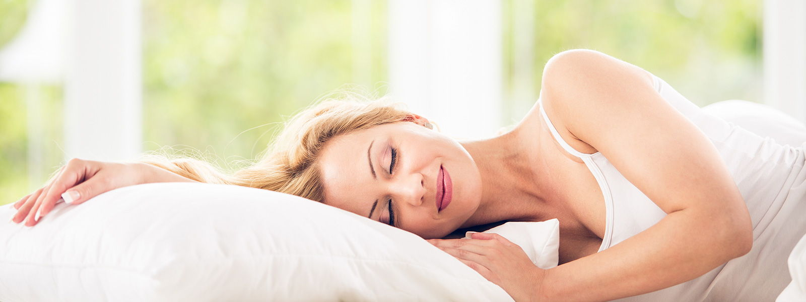 woman sleeping soundly - sleep matters good sleep guide