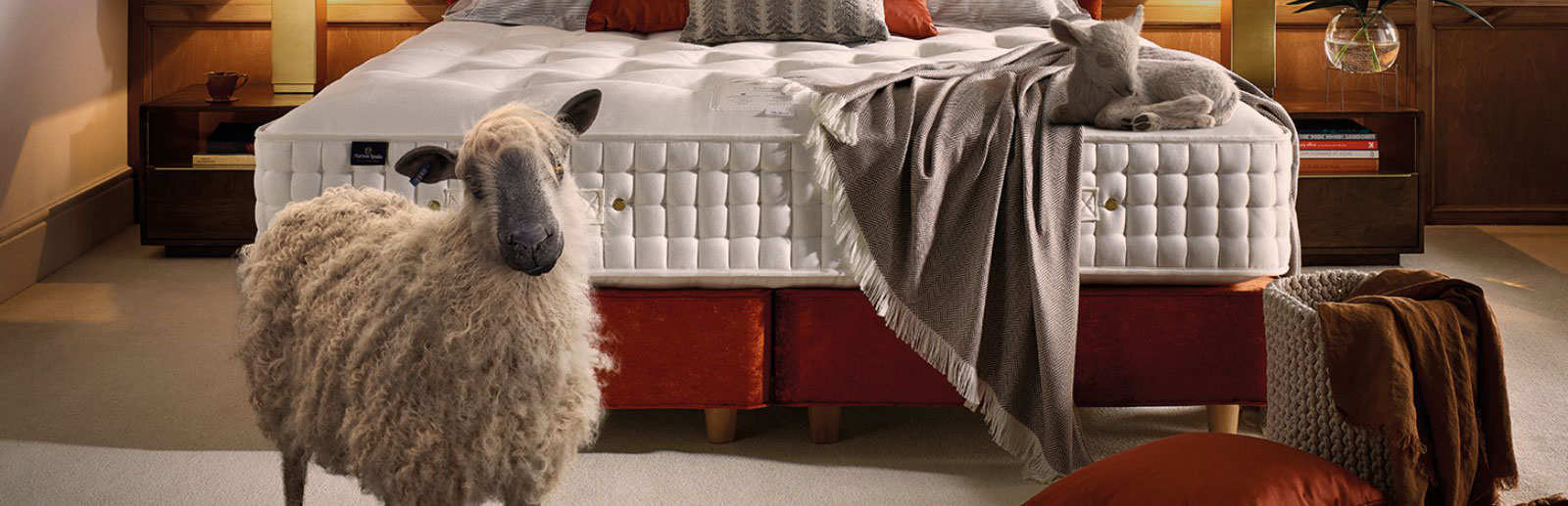 Image of Harrison Mattress and bed with a realistic animated sheep standing in front of it